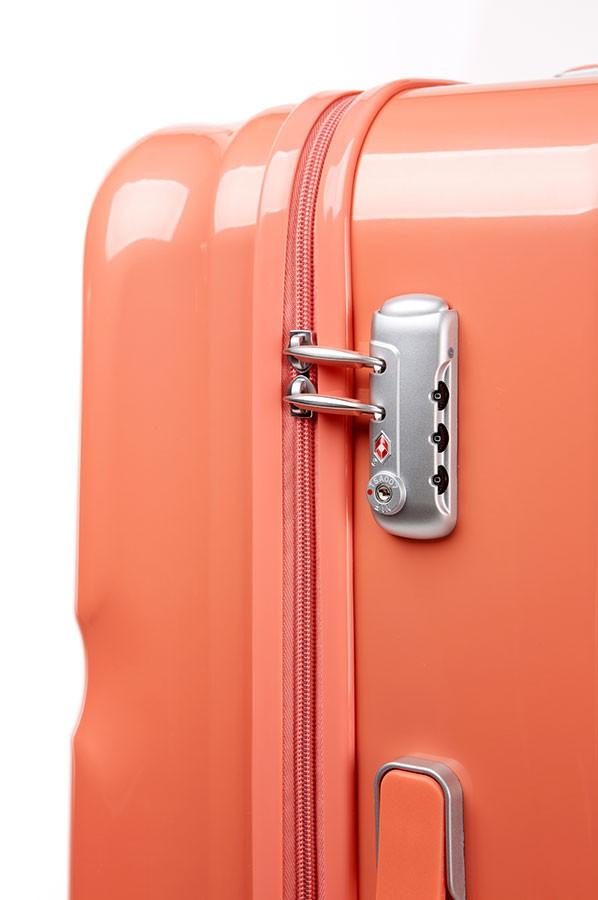 Стилен куфар - цвят корал American tourister