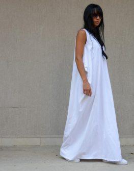 Дизайнерска рокля с ефектна линия Kotyto